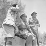 BRITISH ARMY OPERATIONS AGAINST THE MAU MAU IN KENYA 1952 - 1956 (MAU 821) Lieutenant General Sir George Erskine, Commander-in-Chief, East Africa (centre), observing operations against the Mau Mau. In May 1953, General Erskine was given control of all military units plus police and auxiliary troops. Copyright: © IWM. Original Source: http://www.iwm.org.uk/collections/item/object/205191322