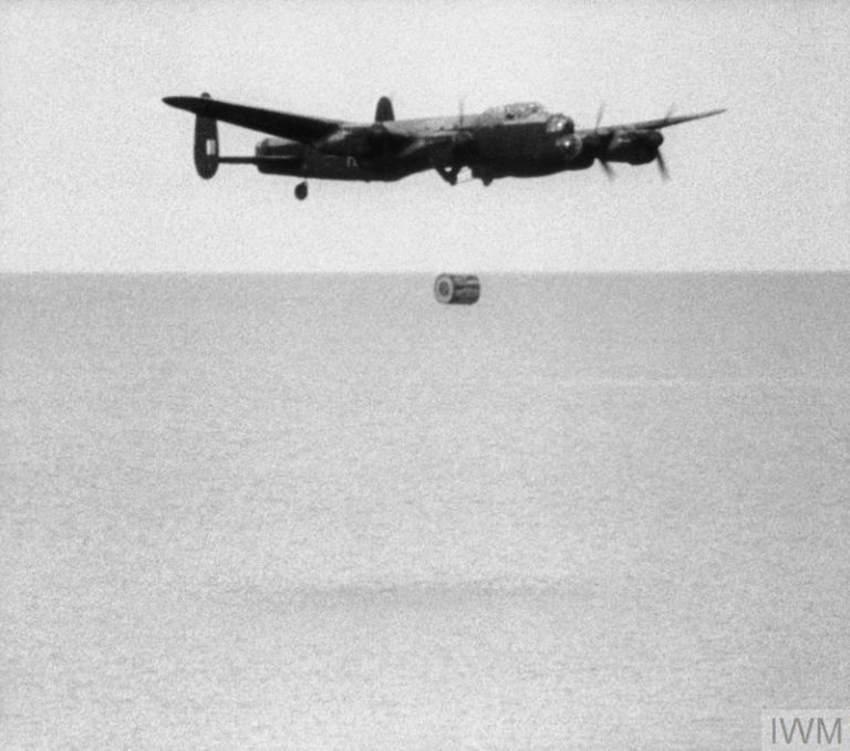 ROYAL AIR FORCE BOMBER COMMAND, 1942-1945. (IWM FLM 2340) Operation CHASTISE: the attack on the Moehne, Eder and Sorpe Dams by No. 617 Squadron RAF on the night of 16/17 May 1943.  No. 617 Squadron practice dropping the 'Upkeep' weapon at Reculver bombing range, Kent.  Second launch sequence (3): the bomb falls from the Lancaster as the aircraft begins to climb. Copyright: © IWM. Original Source: http://www.iwm.org.uk/collections/item/object/205022911