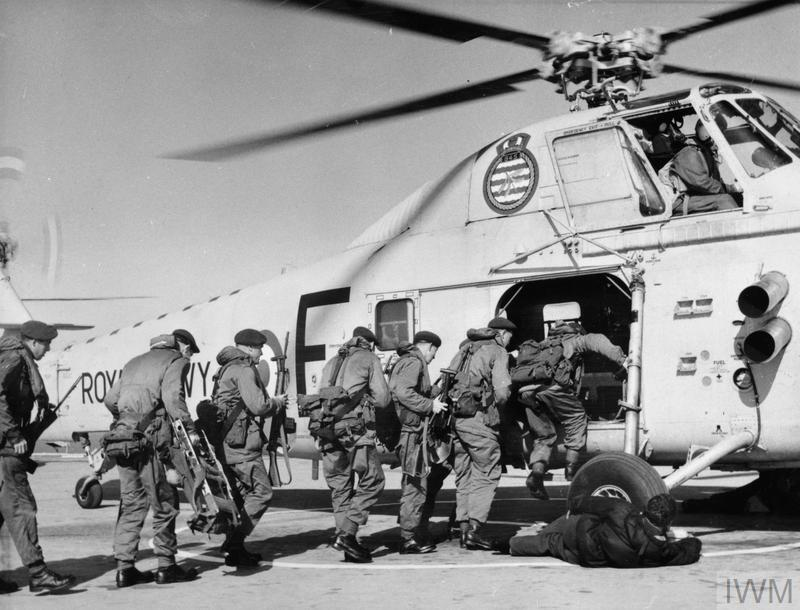 Flight deck scene as Royal Marines of 41 Commando embark in a Wessex helicopter.