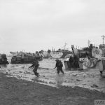 D-DAY - BRITISH FORCES DURING THE INVASION OF NORMANDY 6 JUNE 1944 (B 5246) Commandos of 47 (RM) Commando coming ashore from LCAs (Landing Craft Assault) on Jig Green beach, Gold area, 6 June 1944. LCTs can be seen in the background unloading priority vehicles for 231st Brigade, 50th Division. Copyright: © IWM. Original Source: http://www.iwm.org.uk/collections/item/object/205193123