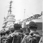 3rd Battalion, The Parachute Regiment, boarding HMS 'Triumph' at Portsmouth bound for Cyprus, 4 June 1951 The battalion was sent to Cyprus during the Anglo-Iranian oil crisis. After a short stint on the island it was then flown into Egypt in December for a tour of duty in the Suez Canal Zone. © Crown Copyright NAM [Image number: 89655]