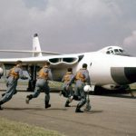 The crew of a Valiant bomber 'scramble!' during a visit to Wyton by HRH the Duke of Edinburgh, 24 June 1958. Source: RAF, MOD