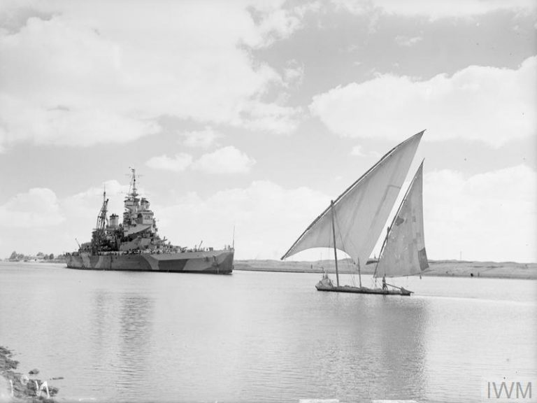 HMS HOWE PASSING THROUGH THE SUEZ CANAL. 14 JULY 1944, SUEZ CANAL AREA. (A 24896) HMS HOWE closing an Egyptian felucca during passage of the Suez canal. Copyright: © IWM. Original Source: http://www.iwm.org.uk/collections/item/object/205156722