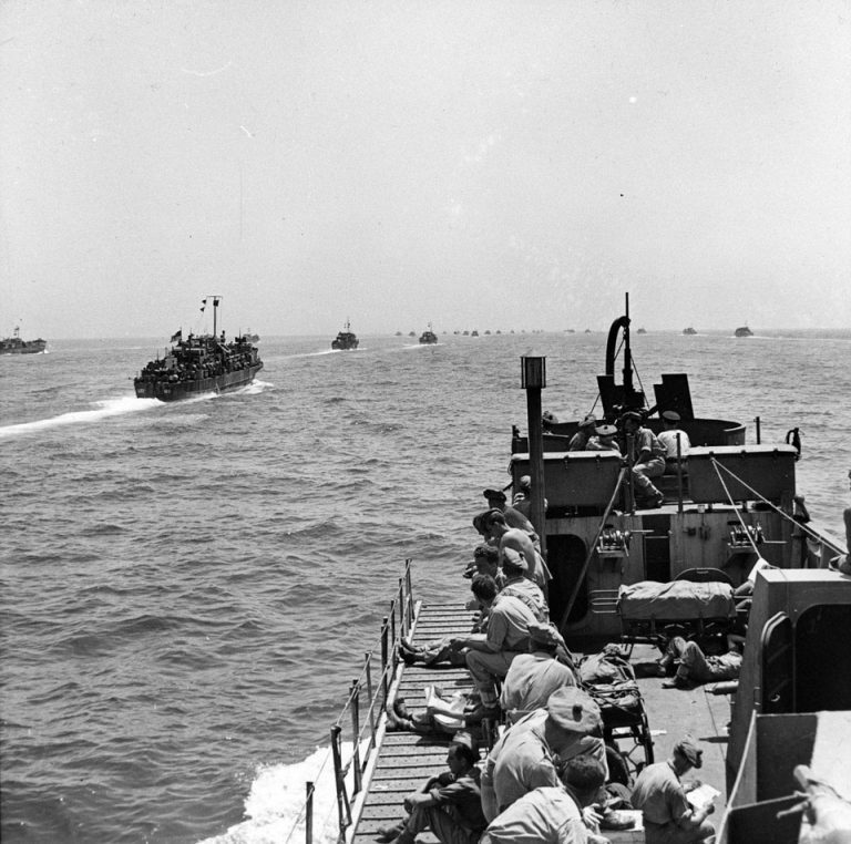 Landing craft of the Sicily invasion armada setting sail, July 1943. The Allied invasion of Sicily, codenamed Operation Husky, began on 9 July 1943, and ended on 17 August. At the time it was the largest amphibious operation of the war. © Crown NAM. 1999-03-88-23