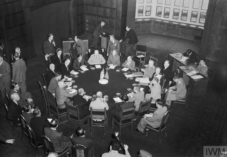 THE POTSDAM CONFERENCE, JULY 1945 (BU 8985) Josef Stalin, Prime Minister Winston Churchill and President Truman with their staffs around the conference table at Potsdam. Copyright: © IWM. Original Source: http://www.iwm.org.uk/collections/item/object/205193813
