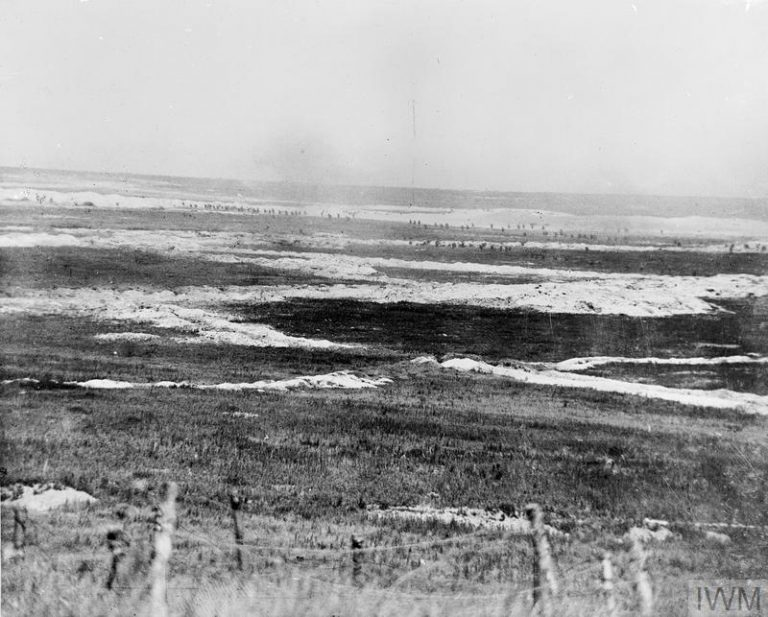 THE BATTLE OF THE SOMME, JULY-NOVEMBER 1916 (Q 87) Somme Offensive, Battle of Albert. Panoramic view of  British troops, visible as dots just below the horizon, attacking German trenches near Mametz, on 1 July.  The trench lines are clearly marked by the white chalk excavated during their construction. Copyright: © IWM. Original Source: http://www.iwm.org.uk/collections/item/object/205193868