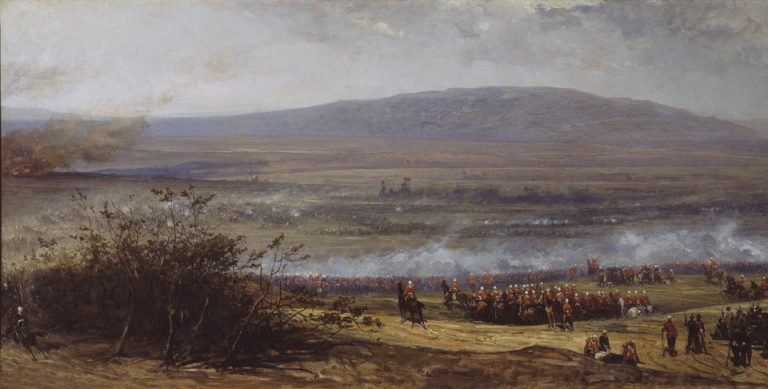 The Battle of Ulundi, Zulu War, 4 July 1879. The Battle of Ulundi, close to the capital of the Zulu King Cetshwayo, was fought between Lieutenant General Lord Chelmsford's force of about 5,000 British and colonial troops and an estimated 20,000 Zulus. The well-disciplined warriors converged upon the British, who formed a square of infantry enclosing staff, cavalry, and supplies. Heavy fire from Gatling guns cut the Zulus down at long range.  The scene represents a late stage of the battle viewed from the centre of the British position when the 17th Lancers (left, middle distance) charged the enemy flank, putting them to flight.  © NAM. 1965-09-46-1