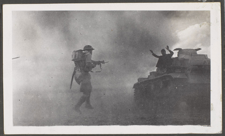 A British infantryman capturing a German tank crewman at El Alamein, 1942