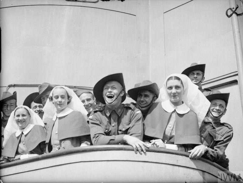 EMPIRE FORCES IN GREAT BRITAIN 1939-1945 (H 1821) Troops and nursing sisters of the 2nd Australian Imperial Force line the rails of a troopship as it docks at Gourock on the Clyde, 19 June 1940. Copyright: © IWM. Original Source: http://www.iwm.org.uk/collections/item/object/205196891