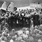 THE MUNICH AGREEMENT, SEPTEMBER 1938 (D 2239) Neville Chamberlain, the Prime Minister, makes a brief speech announcing ?'Peace in our Time'? on his arrival at Heston Airport after his meeting with Hitler at Munich, 30 September 1938. Copyright: © IWM. Original Source: http://www.iwm.org.uk/collections/item/object/205193839