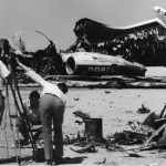 On This Day: 9th September 1970 : Palestinian Guerrillas Hijack a BOAC British Airliner from India bound for London and forced it to land in the Jordanian Dessert. This was the 4th hijacking plot that week by the group calling themselves the Popular Front for the Liberation of Palestine who demanded the release of 3 Arab prisoners held in West Germany. The BOAC Plane joined a Swissair DC8 and a Transworld Airlines Boeing 707 at the airstrip.  Image: Journalists film the wreckage of exploded passenger planes at Dawson's Field, Zarqa, Jordan.  (Peter Davis/Getty Images)