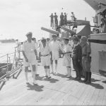 PENANG CONFERENCE ON BOARD HMS NELSON. 28 AUGUST TO 2 SEPTEMBER 1945, ON BOARD THE BRITISH BATTLESHIP HMS NELSON, FLAGSHIP OF VICE ADMIRAL H T C WALKER. DURING THE PENANG SURRENDER AND RE-OCCUPATION NEGOTIATIONS. REAR ADMIRAL UZUNI AND THE JAPANESE GOVERNOR OF PENANG SIGNED FOR THE JAPANESE AFTER WHICH THE DOCUMENTS OF AGREEMENT WERE SIGNED BY VICE ADMIRAL H T C WALKER AT 2115 HOURS ON 1 SEPTEMBER 1945. ROYAL MARINES OF THE BRITISH EAST INDIES FLEET FORMALLY TOOK OVER THE ISLAND ON 3 SEPTEMBER 1945. (A 30472) The Japanese officers arrive on board the NELSON, one is carrying a chart and in the centre is Captain Hidaka, Senior Japanese Naval Officer at Penang. Copyright: © IWM. Original Source: http://www.iwm.org.uk/collections/item/object/205161601