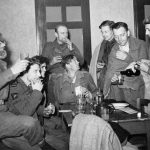OPERATION 'MARKET GARDEN' (THE BATTLE FOR ARNHEM): 17 - 25 SEPTEMBER 1944 (HU 5417) Arnhem 17 - 25 September 1944: A group of survivors from the Arnhem Operation arriving at Nijmegen after the evacuation and having their first drink. One of them, Captain Jan Linzel (second from left) is a member of the Dutch Royal Navy attached to No 10 Commando. Copyright: © IWM. Original Source: http://www.iwm.org.uk/collections/item/object/205021987