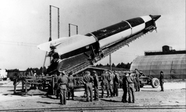 On This Day: 8th September 1944 - Germany launches the first V2 rocket on London Over the next six months Germany launched 1,400 at Britain ending in March 1945.  German V2 rocket being placed into position by soldiers prior to a launch. Photograph: Paul Popper/Popperfoto/Getty Images #WW2