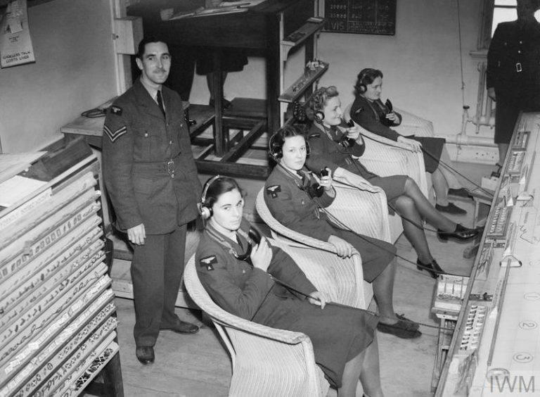 THE BATTLE OF BRITAIN, JULY-OCTOBER 1940 (CH 1404) WAAF telephone operators in the Sector 'G' Operations Room at RAF Duxford, receiving reports of enemy aircraft plots from Observer Corps posts, September 1940. Copyright: © IWM. Original Source: http://www.iwm.org.uk/collections/item/object/205209961